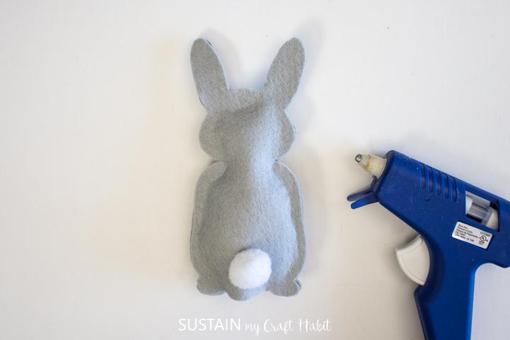 Gluing a pom pom onto a felt bunny.