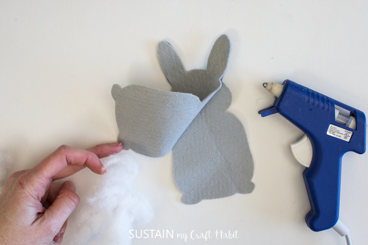 Gluing two pieces of felt bunny fabric together.