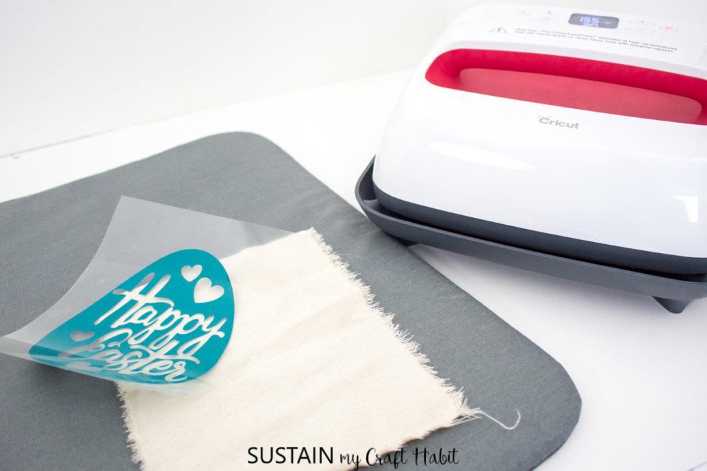 Preparing the Cricut EasyPress, mat, fabric and cut image.