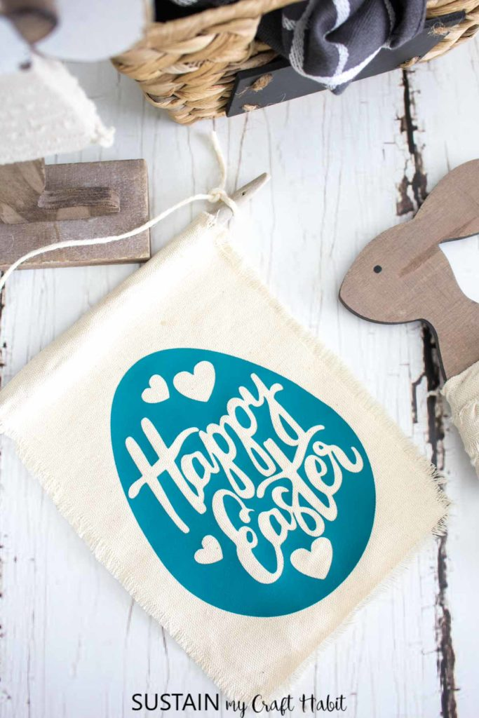 Finished mini happy Easter banner next to Easter decor.