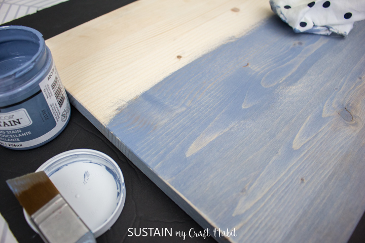 Painting the surface of a piece of pine wood.