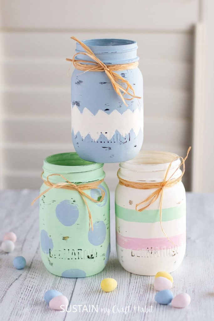painted Easter jars stacked on a table