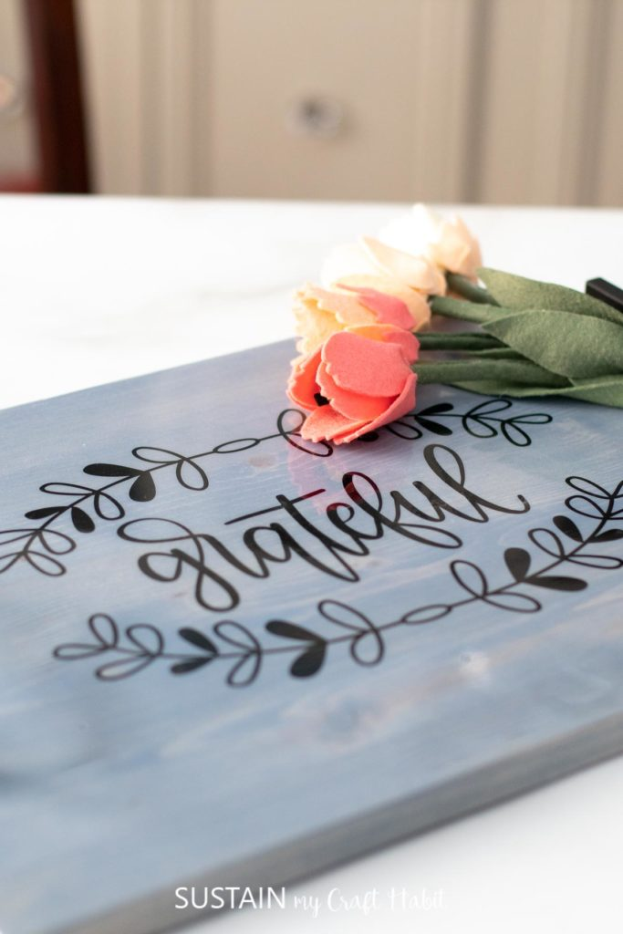 """Finished farmhouse inspired wood serving tray with the words """"grateful."""""""