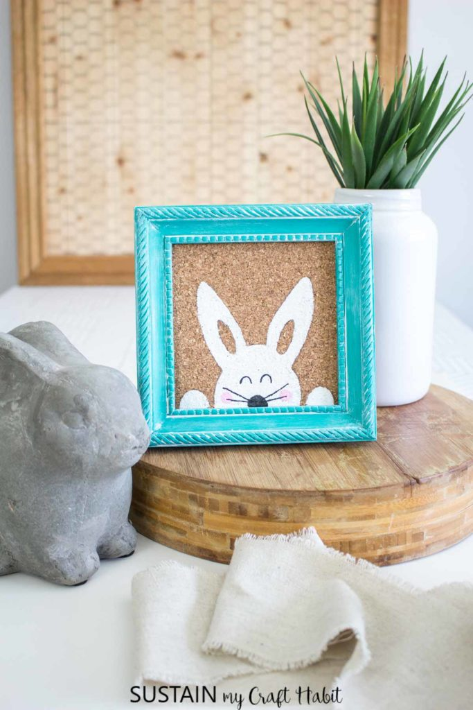 Painted Easter bunny in a blue frame.