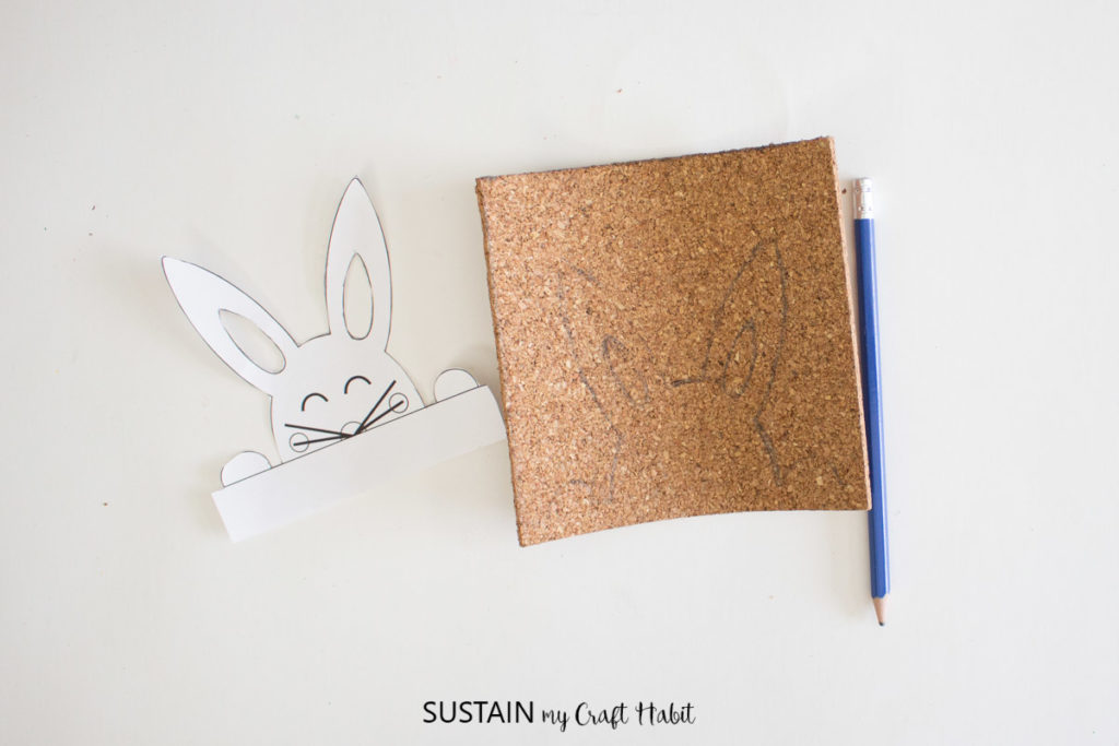 Traced Easter bunny onto the cork sheet.