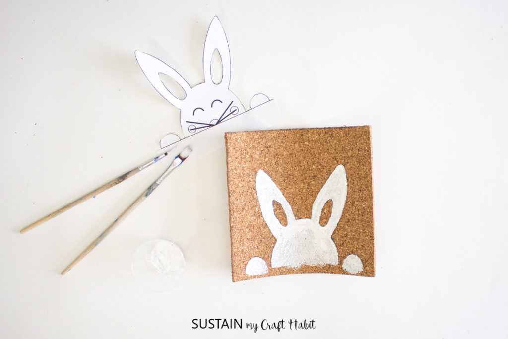 Painting the cork sheet to make a bunny.