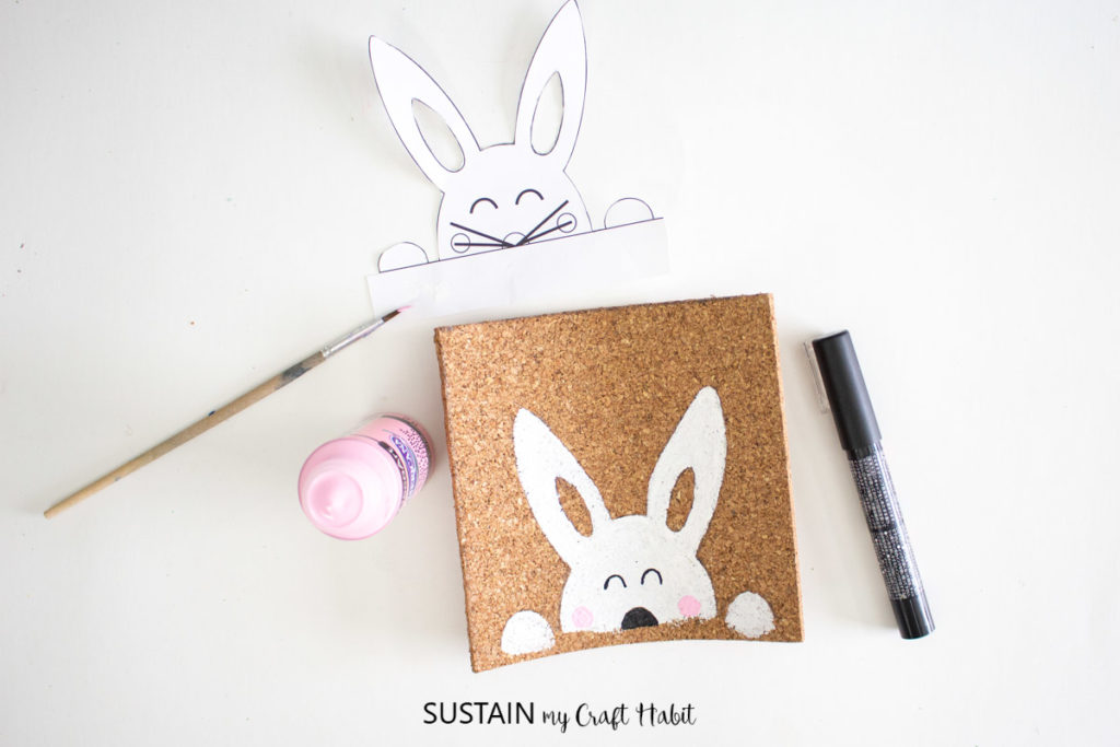 Painting half circles as eyes for the painted Easter bunny.
