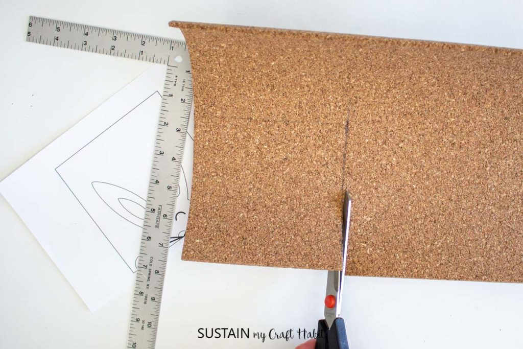 Cutting a piece of cork sheet paper.