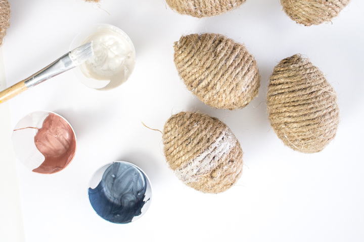 twine wrapped eggs, paint and paint brushes.