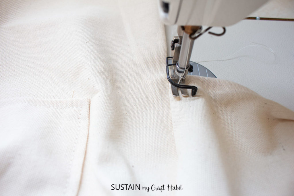 Stitching the canvas for an allowance in the back.