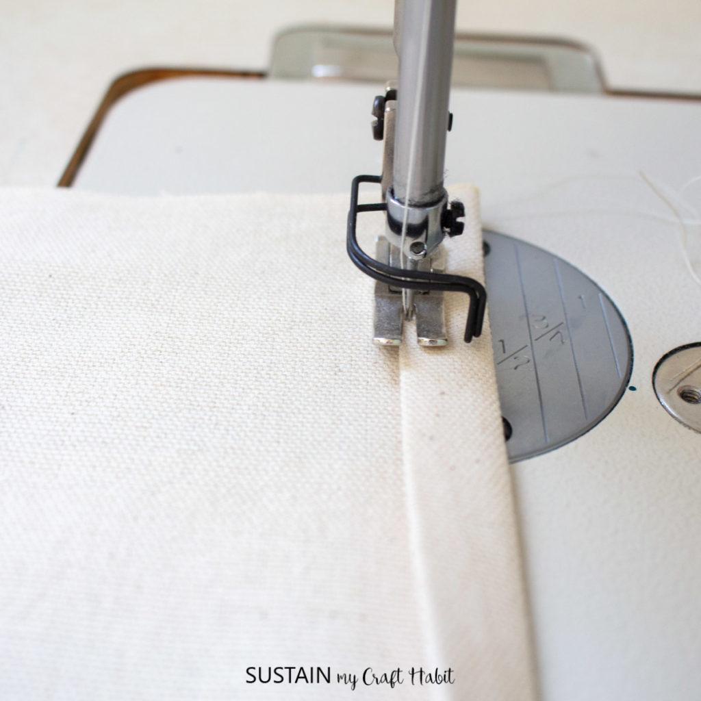 Stitching the hem.