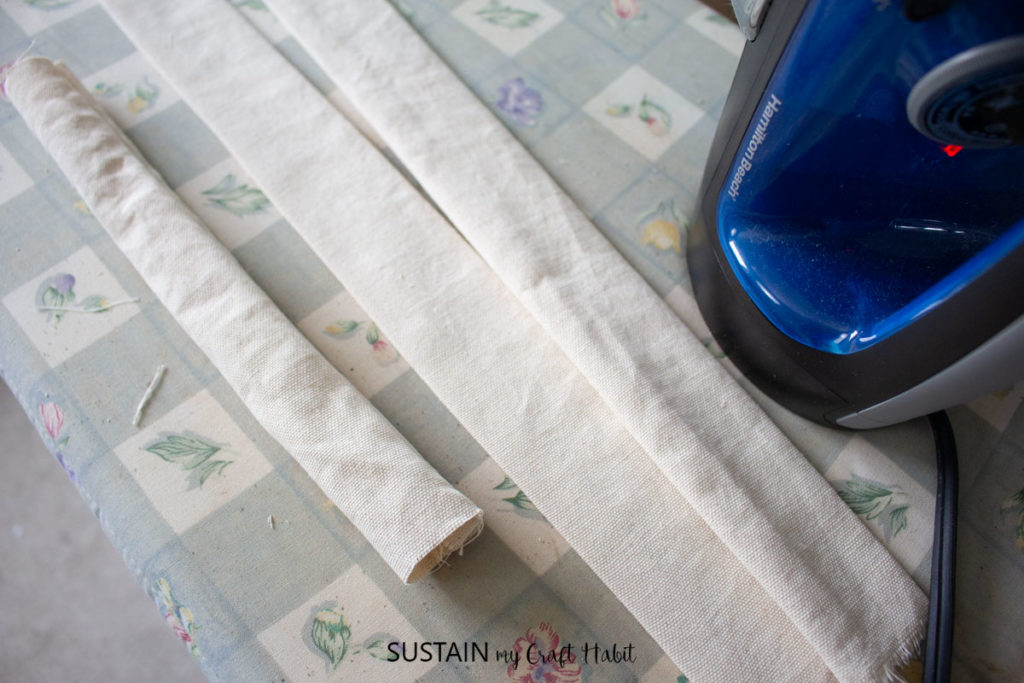 Ironing the canvas fabric.