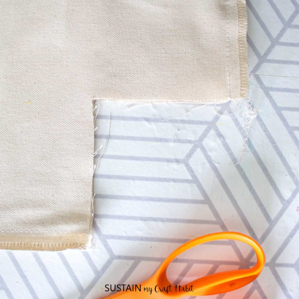 Cutting out a piece of fabric.