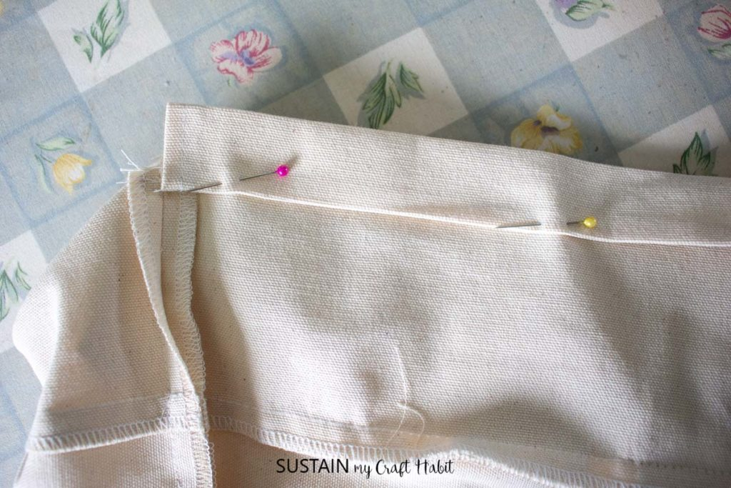 Pinning the hem in place.