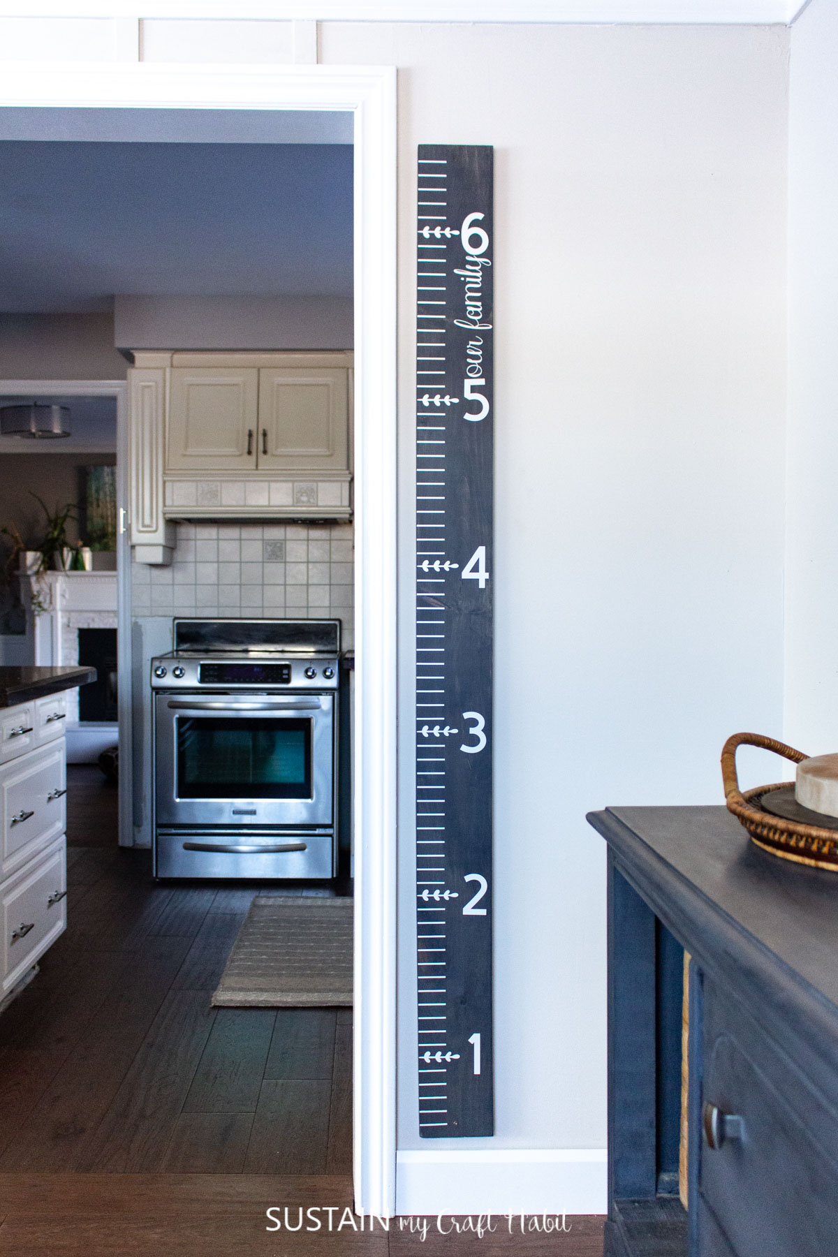 wooden growth chart hanging on the wall