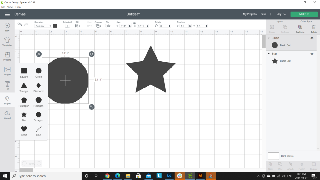 Adding a moon and stars in Cricut design space.