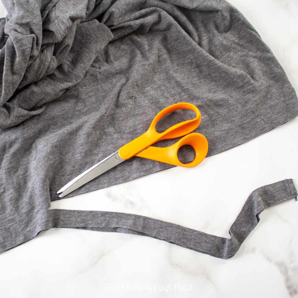 Cutting rayon fabric.