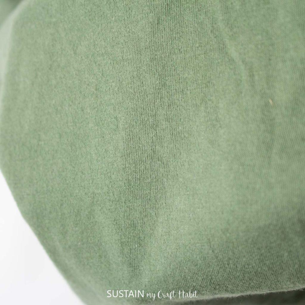Green jersey knit fabric.