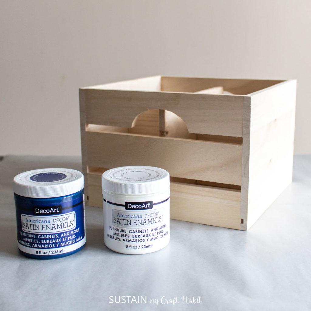 Wooden craft with paint containers.