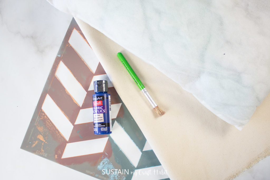 A zig zag stencil, paint and paintbrush.