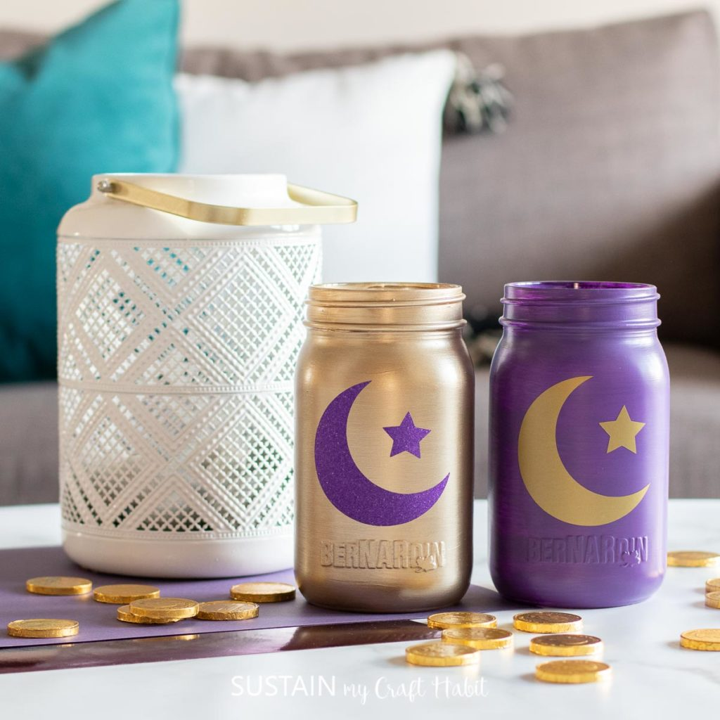 Decorative Eid jars next to a lamp and  scattered coins.