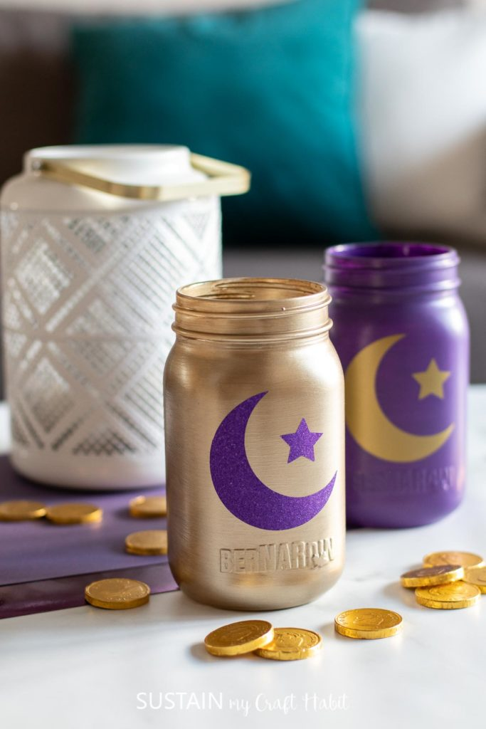 Decorative Eid jars with scattered coins.