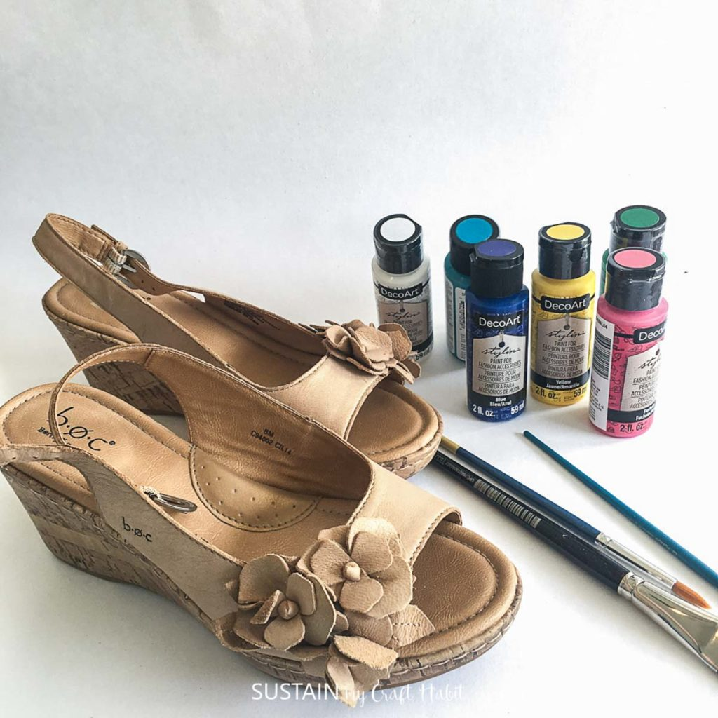 Sandals, paintbrushes and paint.