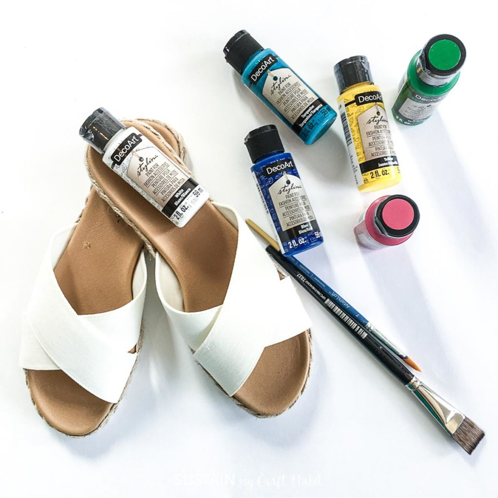White sandals, paintbrush and paint.