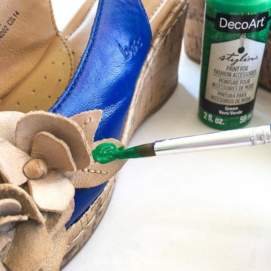 Painting the leaf embellishment on the sandal green.