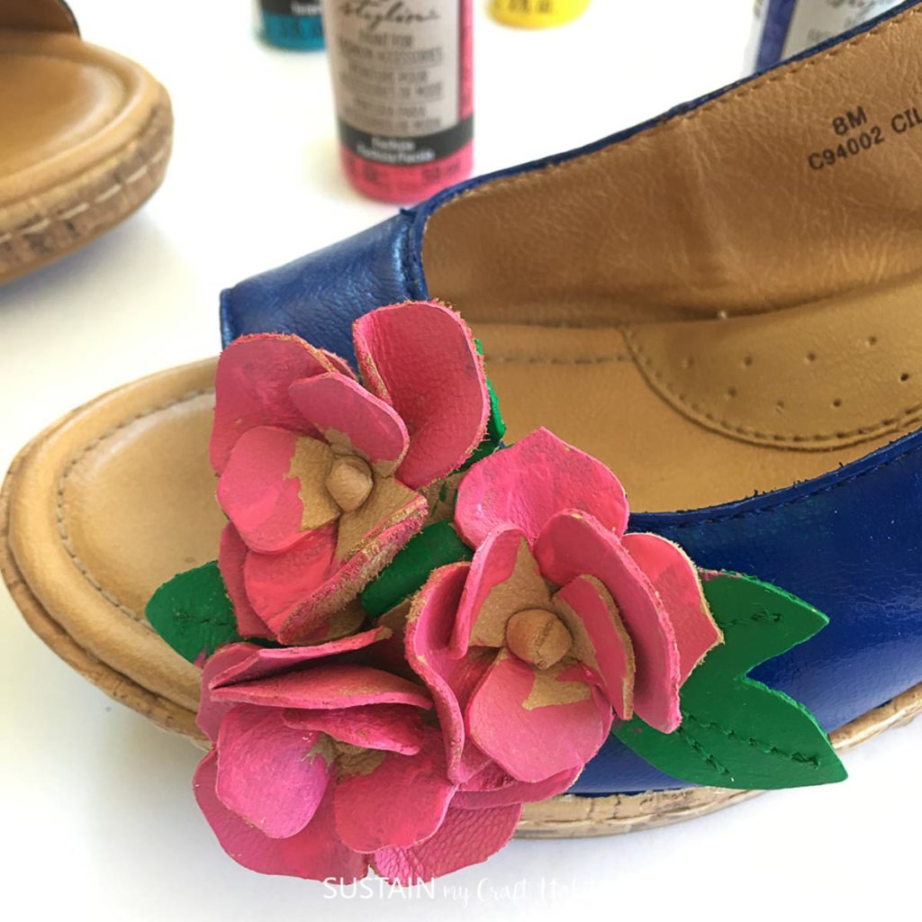 Painting the flower embellishement on the sandal pink.