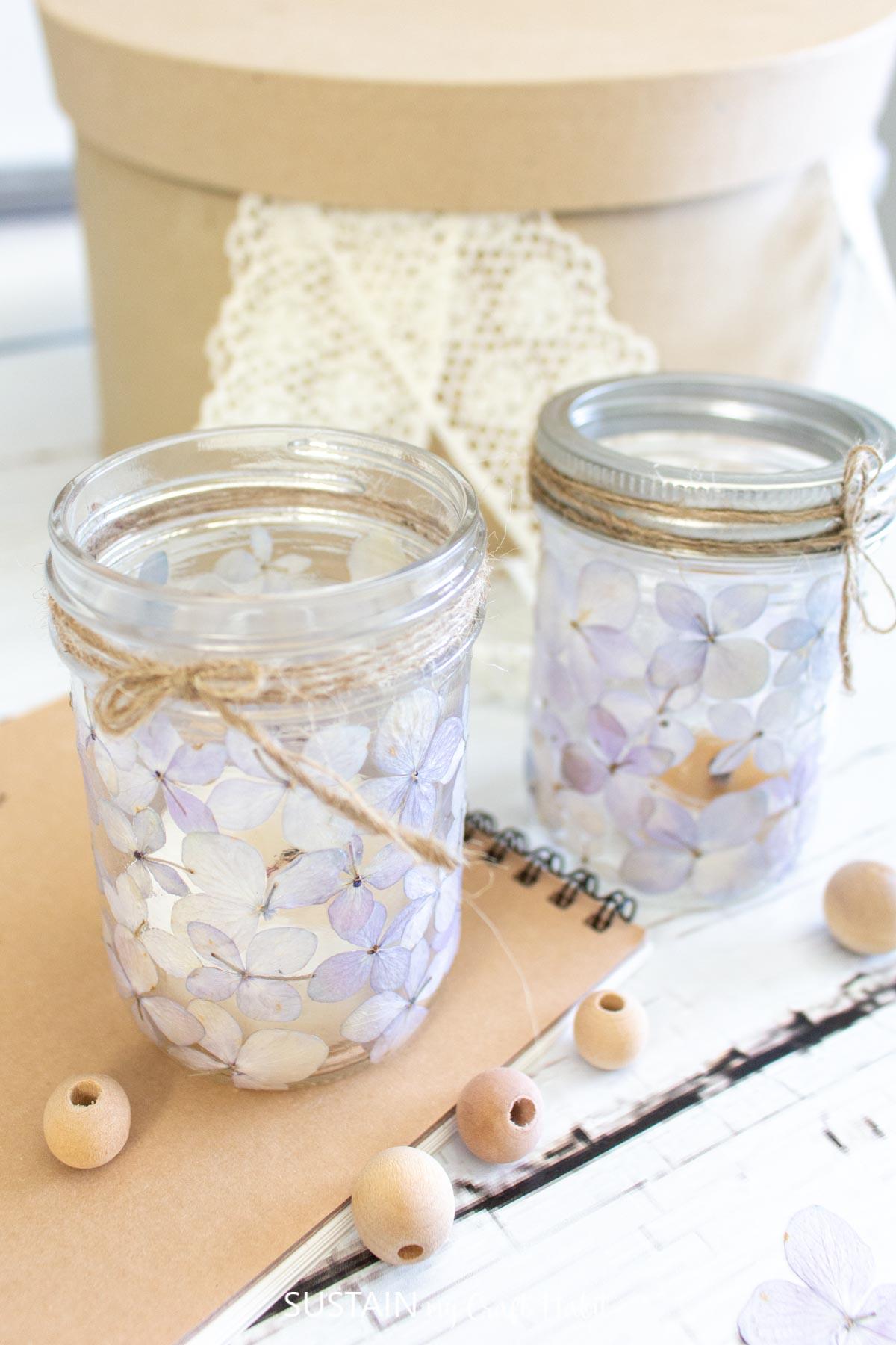 Pressed flower mason jar luminaries with wrapped twine.