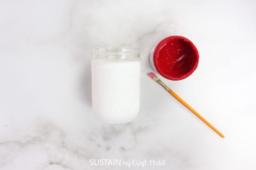 A white painted mason jar.