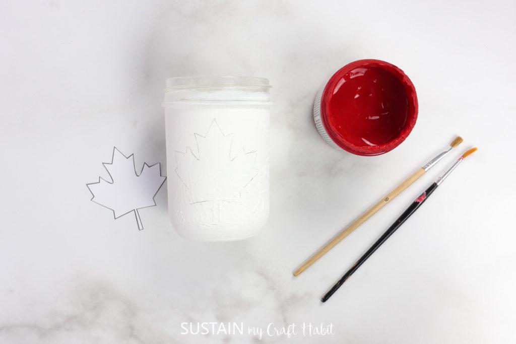 Traced maple leaf image on a jar.