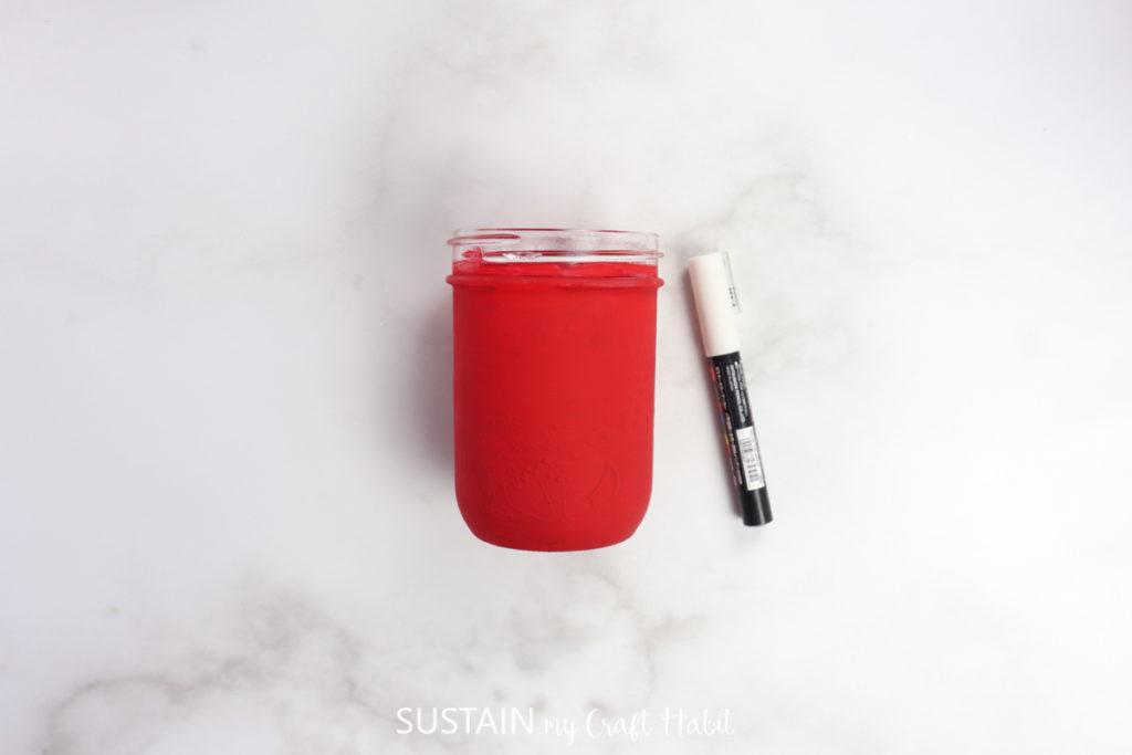 A red painted mason jar.
