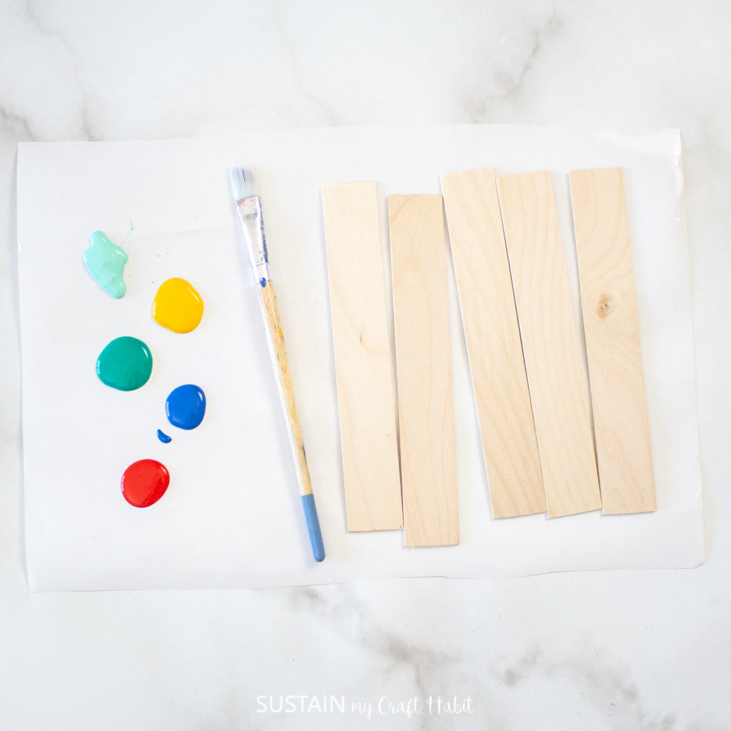 Popsicle sticks, paint brush and paint.