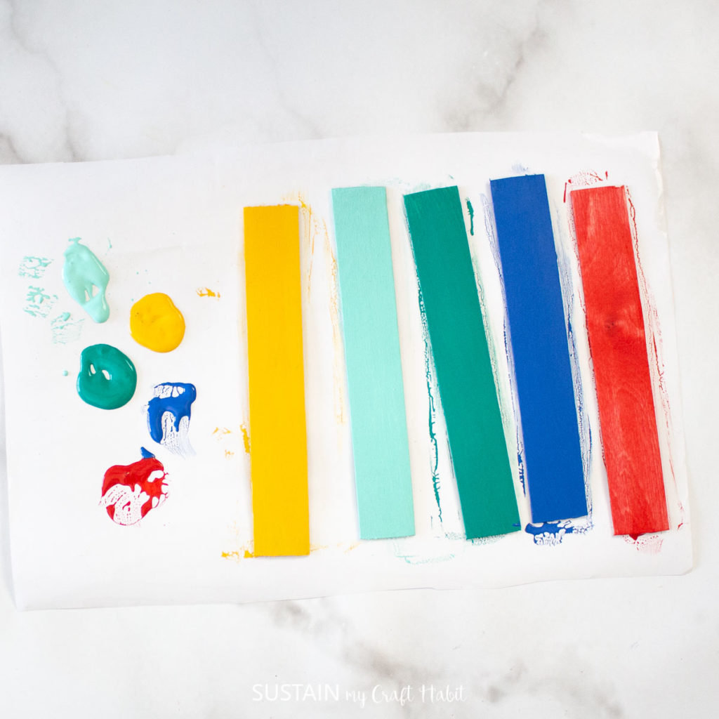 Popsicle sticks each painted a different color.