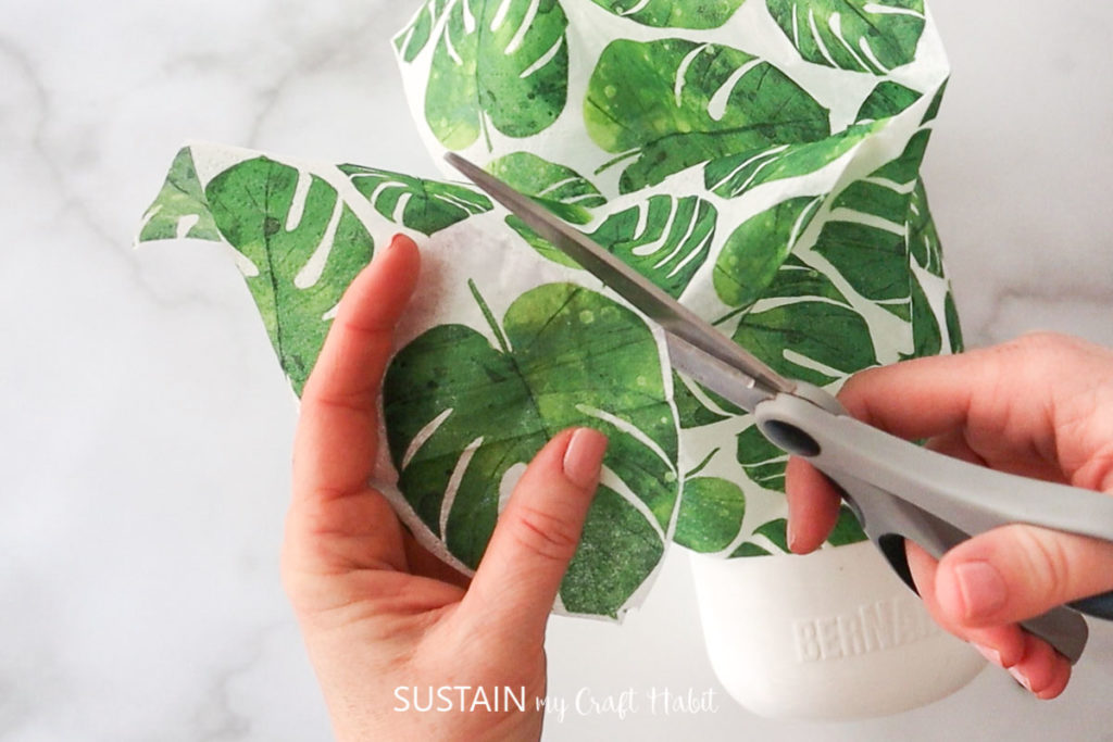 Cutting out individual leaf images from the napkin.