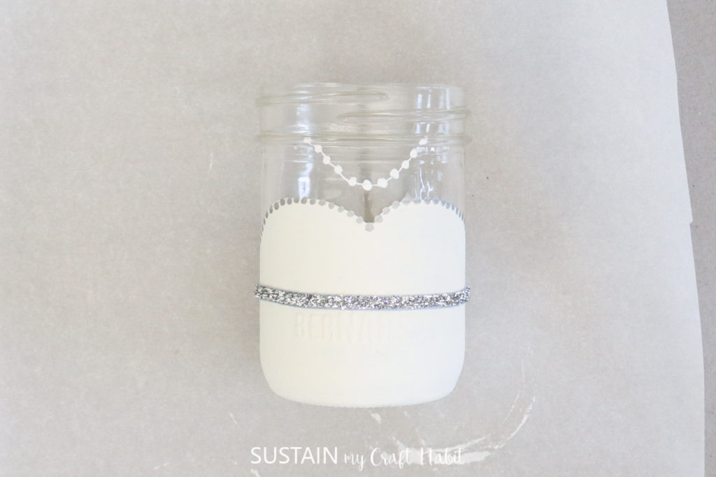 Adding a strip of glitter tape around the painted jar.