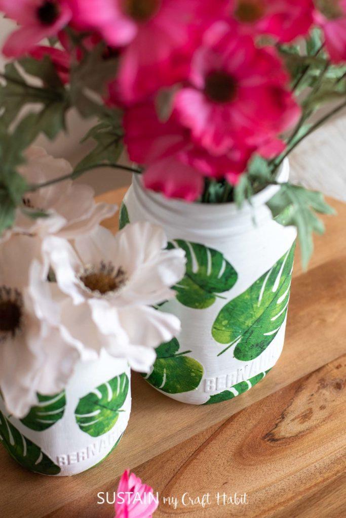close up of beautiful decoupage napkins on simple glass jars