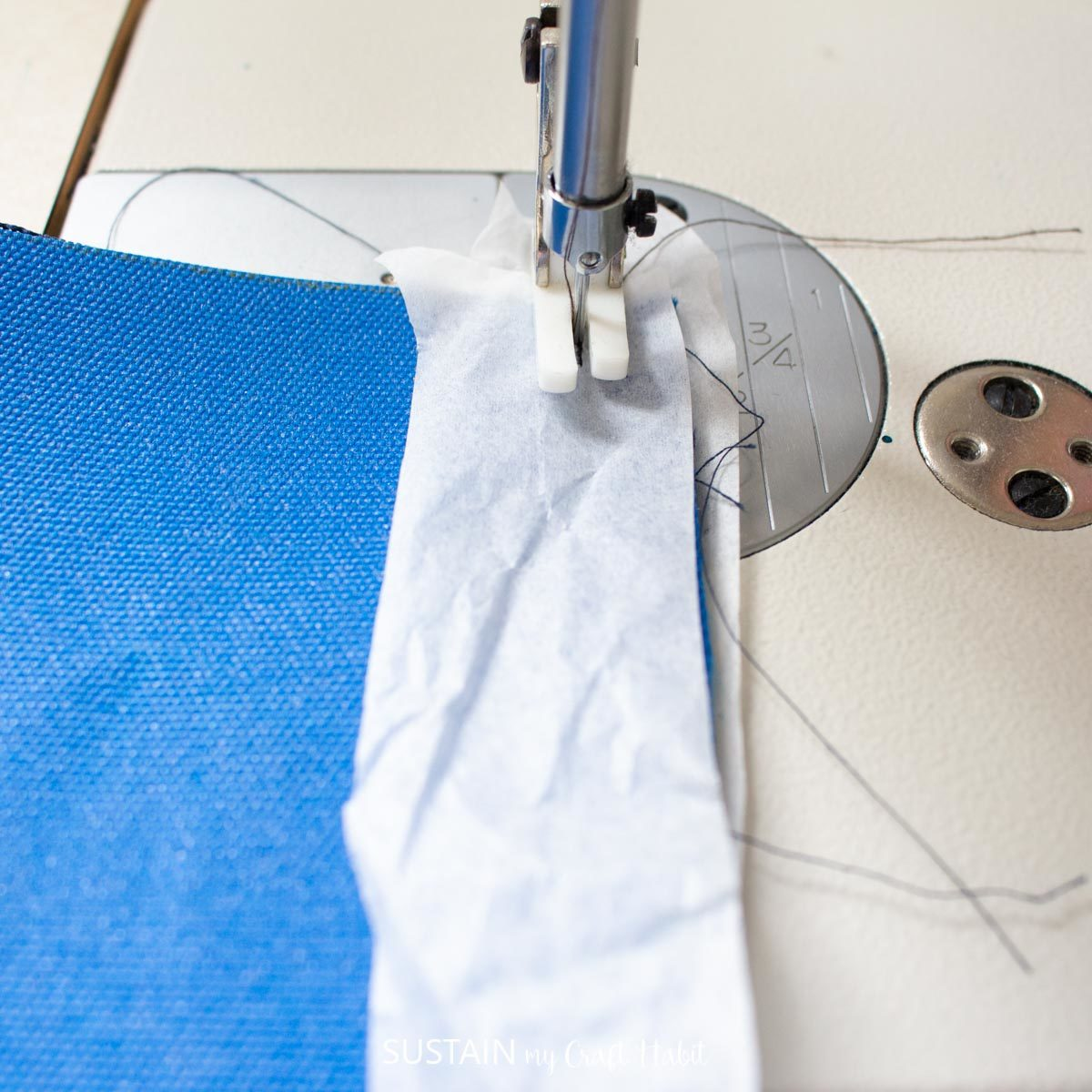 Adding a layer of tissue paper between the fabric and sewing.