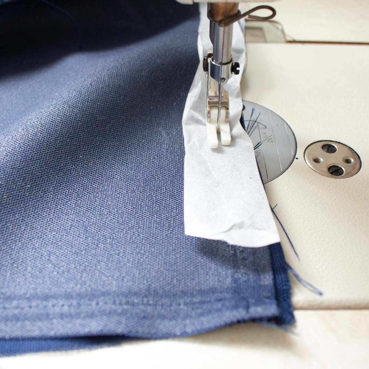 Sewing along the edge of the fabric.