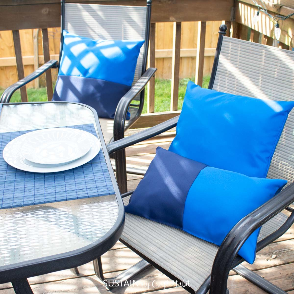 Blue outdoor pillows on chairs.