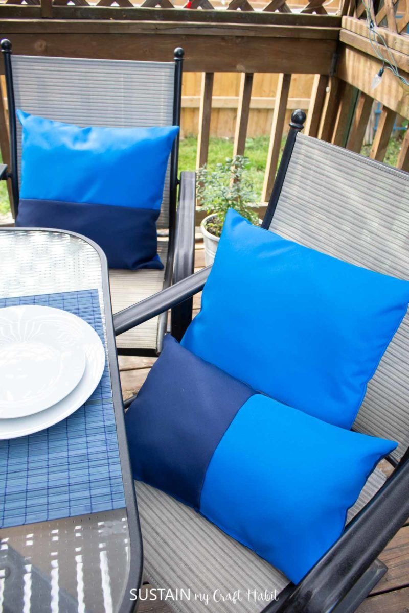 Blue outdoor pillows on a chair.