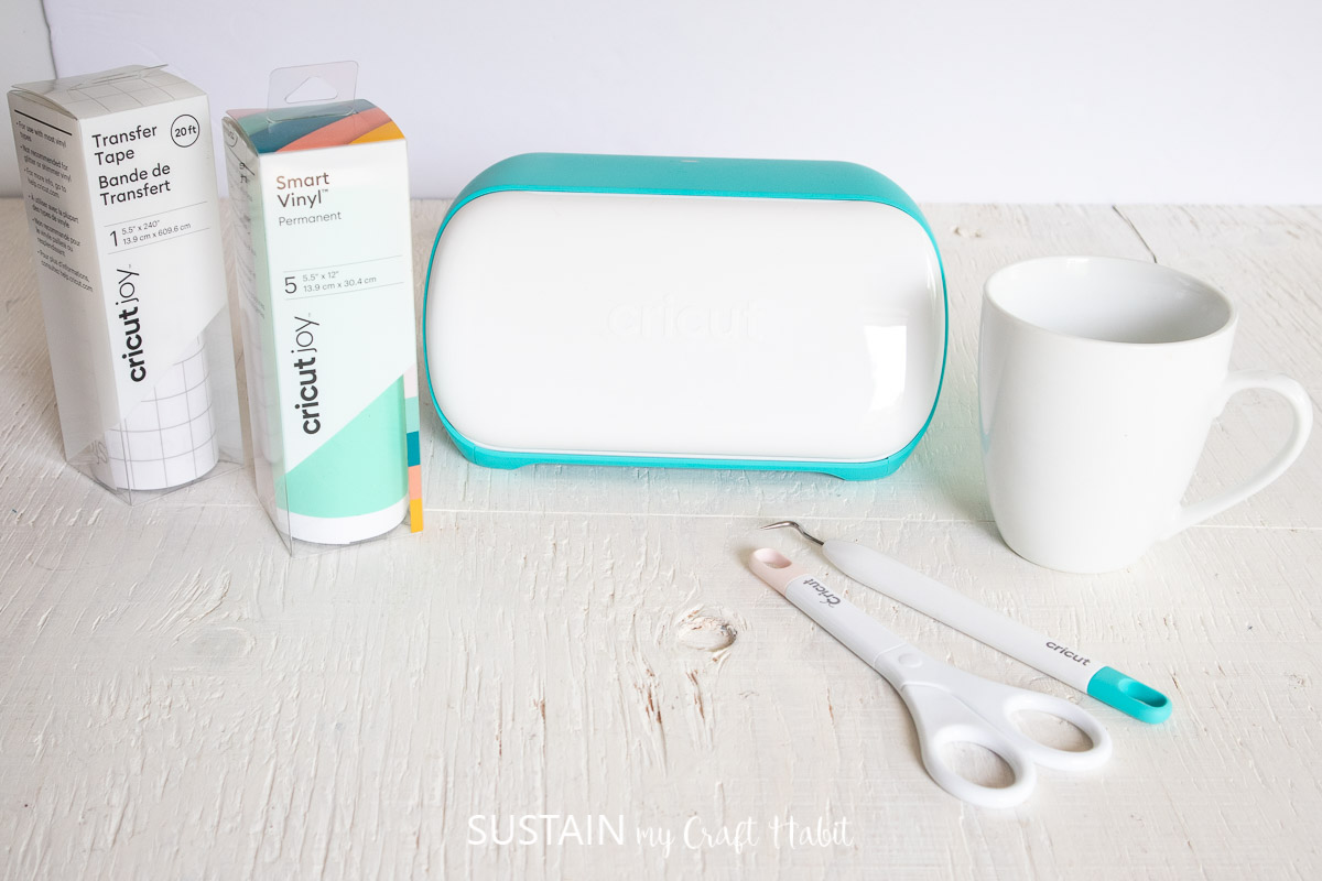 Materials needed to make a mug for teachers including a coffee cup, Cricut machine, vinyl and tools.