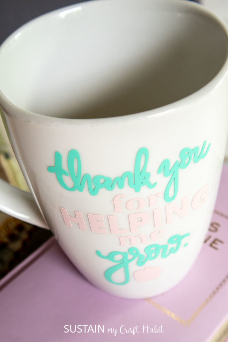"""Close up of the coffee mug for teachers with the phrase """"thank you for helping me grow"""" on the front."""