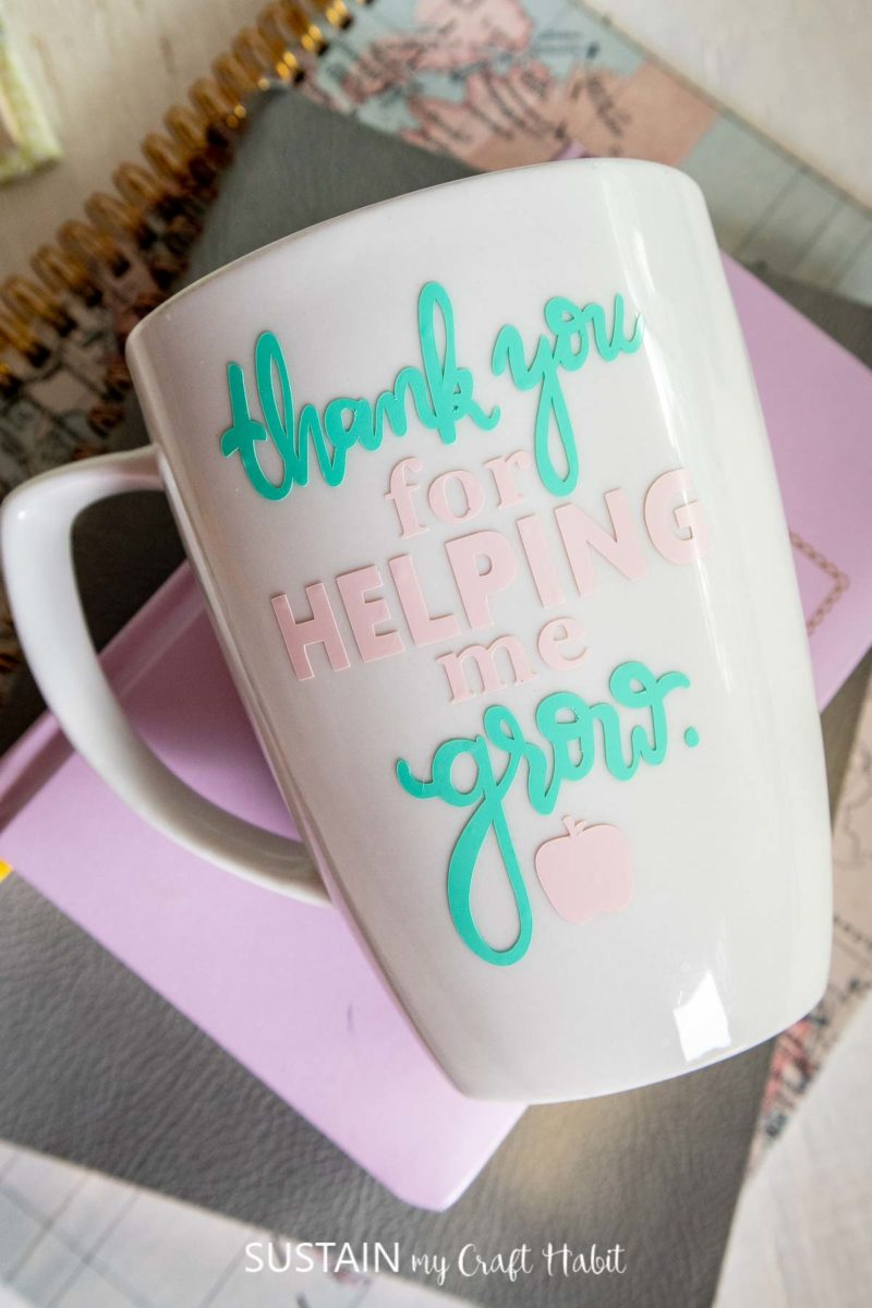 """Overhead view of coffee mug for teachers with """"thank you for helping me grow"""" phrase on the front."""