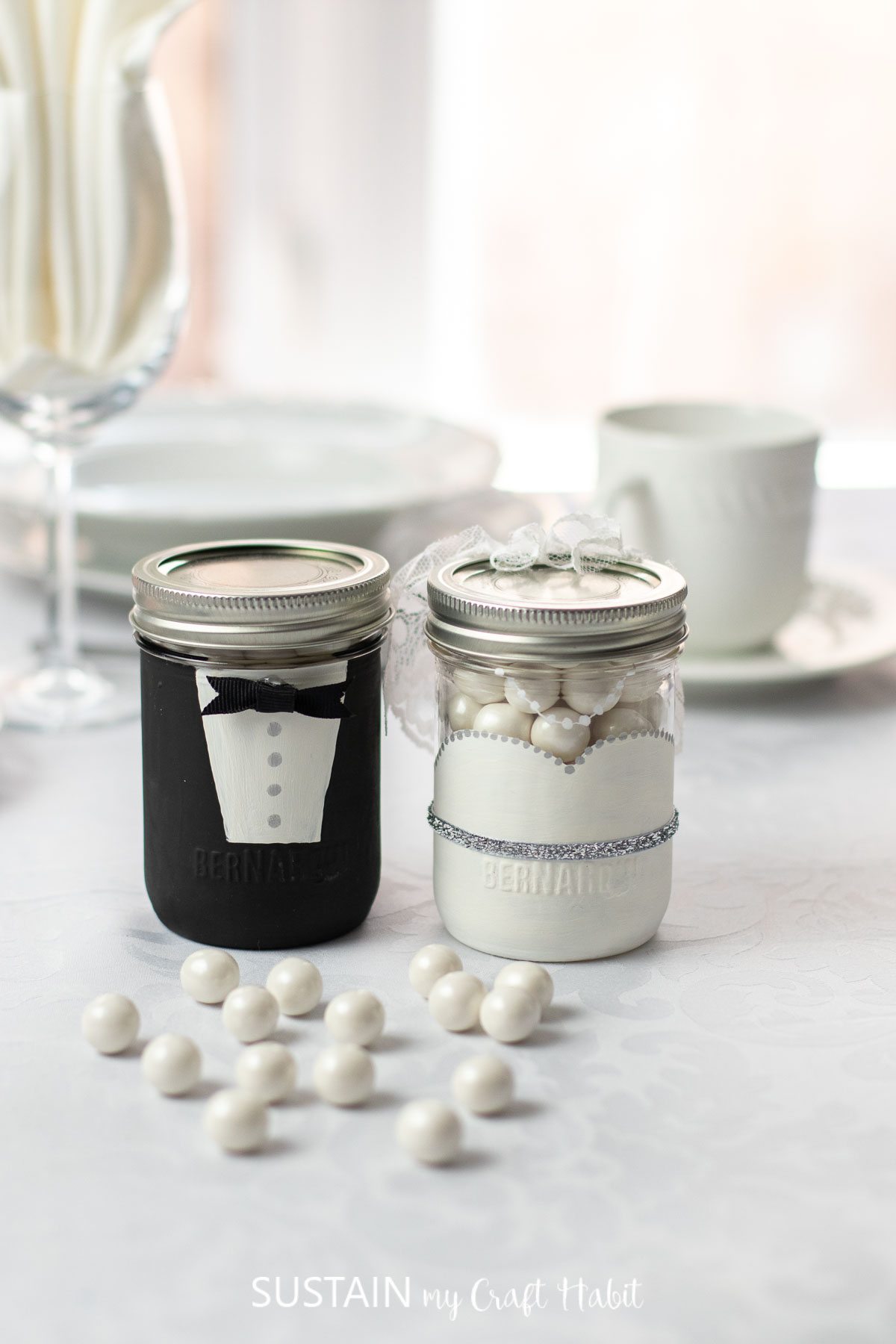 Bride and groom glass jar wedding favors filled with candy.