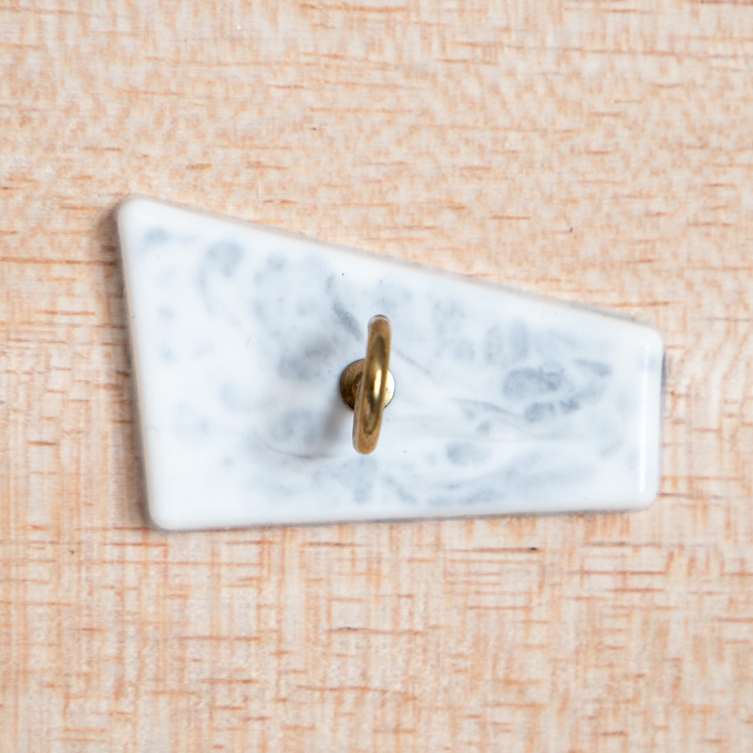 Modern faux resin marble hook.