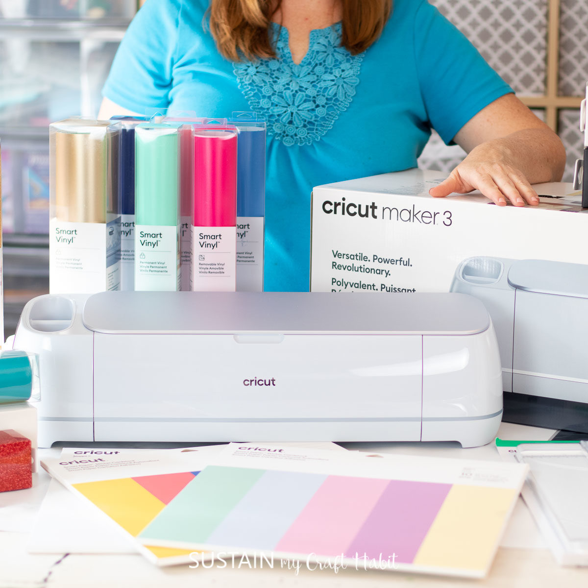 cricut maker 3 on a table in front of a woman