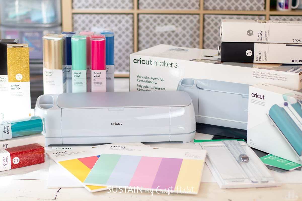 cricut maker 3 on a table with materials and accessories